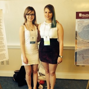 Sarah Gahr and Ali Ditner at the 2014 IASD poster session where they presented.